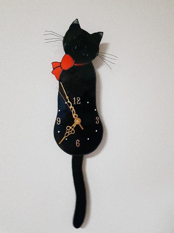 黒猫の振り子時計とサンキャチャー